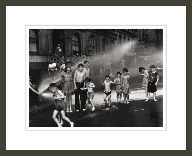 [Children playing in water sprayed from open fire hydrant, Upper West Side, New York]