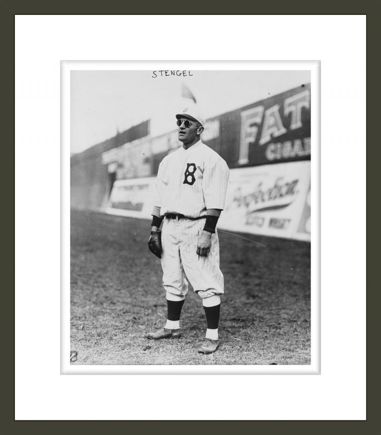 [Casey Stengel, full-length portrait, standing, facing left, wearing sunglasses, while playing outfield for the Brooklyn Dodgers]