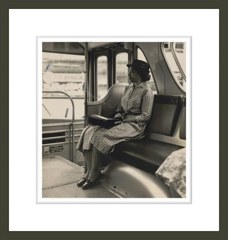 Rosa Parks Seated in Front of a Public Bus