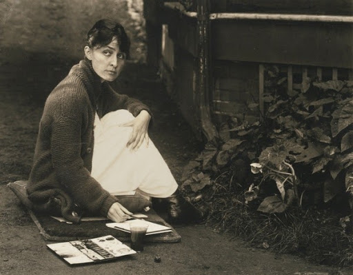 Georgia O'Keeffe (Seated on Ground, Paint Brush in Hand) by Alfred Stieglitz